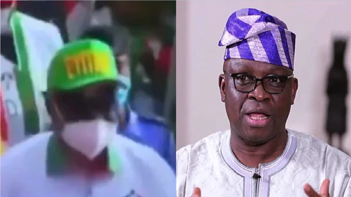 "Video: Commotion as thugs remove ex-governor's cap during PDP rally, says ""I must not die""- Fayose"