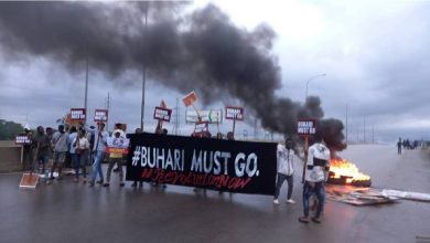"""PHOTOS: """"Buhari Must Go"""" – Youths Protest In Abuja"""